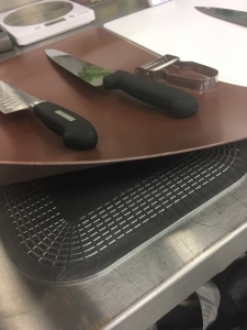 Chef uses Dycem Non-Slip Mat under chopping board